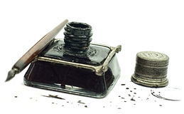 Retro ink bottle and Nib pen. Retro ink bottle with a metal lid and drawing pen Stock Images