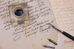 Retro ink pen on old aged paper Royalty Free Stock Images