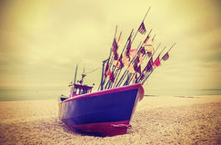 Retro instagram style photo of fishing boat on a beach Royalty Free Stock Image