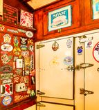 Retro Vintage Interior of American Diner with Refrigerator. Retro interior of an american diner with classic signs and antique icebox refrigerator stock image