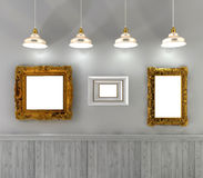 retro interior with empty paintings in gold frame and lamps above Royalty Free Stock Photo