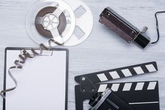 Retro items for filming on a light wooden table stock image