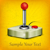 Retro joystick on yellow Stock Images