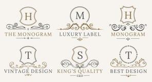 Retro- königlicher Weinlese-Schild-Firmenzeichensatz Vektor calligraphyc Luxuslogogestaltungselemente Geschäfts-Zeichen, Logos Stockfoto