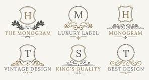 Retro- königlicher Weinlese-Schild-Firmenzeichensatz Vektor calligraphyc Luxuslogogestaltungselemente Geschäfts-Zeichen, Logos Lizenzfreies Stockfoto