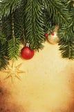 Retro kaart van Kerstmis met grens en decoratie Royalty-vrije Stock Afbeeldingen
