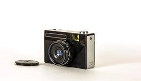 Retro- Kamera für das Machen von Fotos auf Film auf einem hellen Hintergrund Stockbild