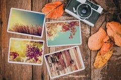 Retro kamera och foto av memorie och nostalgi i nedgång arkivfoton