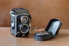 Retro- Kamera Rollieflex und Belichtungsmesser Lizenzfreie Stockbilder