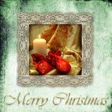 Retro- Kartenweihnachtskerze und -geschenke Stockfoto