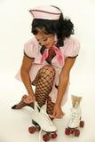 Retro kelnerka z rolkową łyżwą fotografia stock