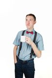 Retro Kerl, der Cup anhält Lizenzfreie Stockfotos