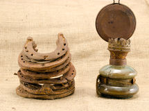 Retro kerosene lamp rusty horse shoes linen Royalty Free Stock Photo