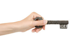 Retro key. Hand and retro key isolated on white background royalty free stock image