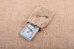 Retro key and bundle of US dollar in a sack Stock Image