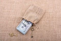 Retro key and bundle of US dollar in a sack Stock Photography