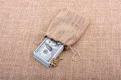 Retro key and bundle of US dollar in a sack Stock Images