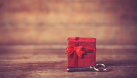 Retro key and little red gift Royalty Free Stock Images