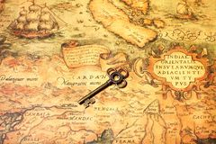 Retro key with map. Retro key with ancient map,key to ancient world concepts Royalty Free Stock Photo