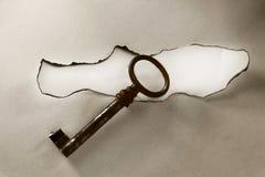 Retro key on paper card Stock Photo