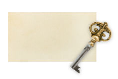 Retro key on paper card Royalty Free Stock Photos