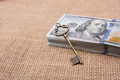 Retro key placed of a bundle of US dollar Royalty Free Stock Photo