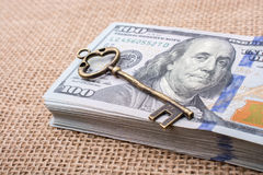 Retro key placed of a bundle of US dollar Stock Photo