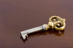 Retro key on wooden table Royalty Free Stock Photography