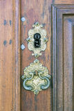 Retro keyhole. An old medieval keyhole on a gold / brass door with a rutsy ornate plate Royalty Free Stock Image