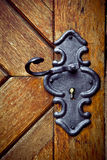 Retro keyhole in old wooden door Royalty Free Stock Photo