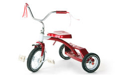 Retro Kid's Red Tricycle. Classic red tricycle, isolated against white background stock photo