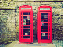 Retro kijk de telefooncel van Londen royalty-vrije stock afbeelding