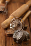 Retro kitchen cookies mould utensils tools on old wooden table i Royalty Free Stock Photography