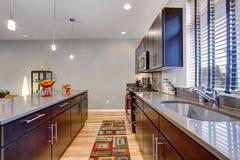 Retro kitchen with modern twist along with hardwood floor. Stock Photos