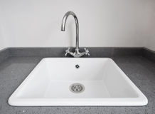 Retro kitchen sink. Large retro style white ceramic kitchen sink royalty free stock photo