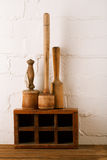 Retro kitchen utensils  mashers on old wooden spice box Stock Photo