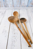 Retro kitchen utensils  wood spoon on old wooden table in rustic Royalty Free Stock Image