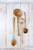 Retro kitchen utensils  wood spoon on old wooden table in rustic Stock Image