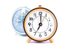 Retro klocka på vit bakgrund Arkivfoton