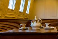 Retro kopp och tefat i nomad- SS, Belfast Royaltyfri Foto