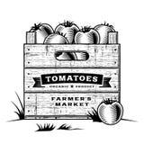 Retro krat van zwart-witte tomaten Stock Foto
