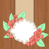 Retro label over brown wood with red flowers and leaves Stock Photography