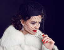 Retro lady. Beautiful Woman in Luxury Fur Coat.  Fashion model I Royalty Free Stock Images