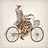 Retro lady cyclist vector illustration Stock Images