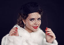 Retro lady with hat. Beautiful Woman in Luxury Fur Coat.  Fashio Royalty Free Stock Photo