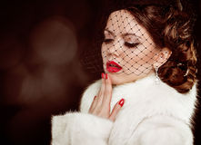 Retro lady portrait. Beautiful Woman in Luxury Fur Coat. Coquett Royalty Free Stock Photos