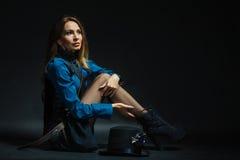 Retro lady sitting. Royalty Free Stock Images