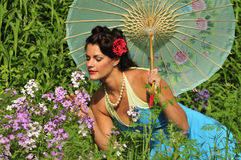 Retro lady in with spring flowers Stock Images