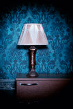 Retro lamp on blue rococo background Stock Photos