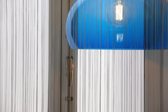 Retro lamp in blue tone with curtain and window Stock Photography